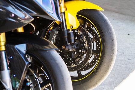 Slick racing tires used for track racing both motorcycle and car. Zdjęcie Seryjne - 120396536