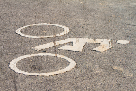 Symbols of bicycle on the street suggests that a bike lane.