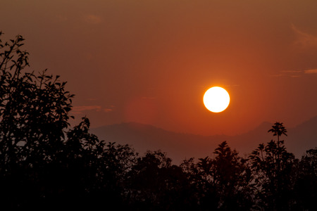 View images of the sunset behind the mountains.