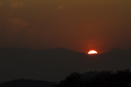 Views of the red sun was falling behind the mountains.