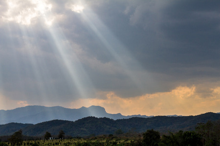 landscape view of The sunlight filtering through the clouds to the ground. 写真素材