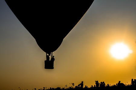 Silhouette balloon floating on air with the light of the evening sun.