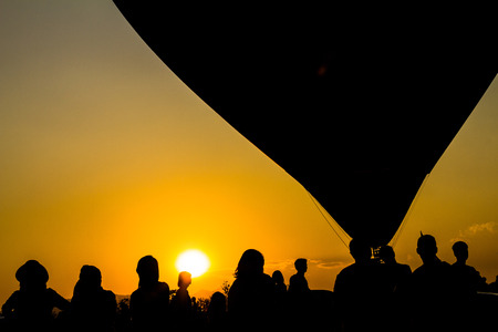 Silhouette balloon floating in the air with the light of the evening sun.