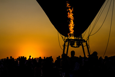 Image of evening light with silhouette balloon.