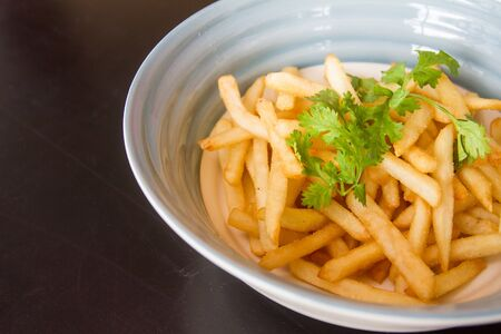 French fries are prepared in a cup and ready to be served.