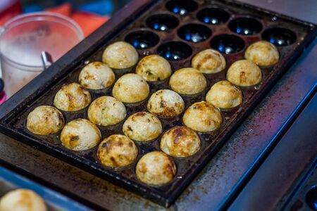 Takoyaki is a snack of Japan. Can be easily purchased at street food