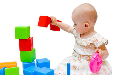 Little baby girl playing with her toys photo