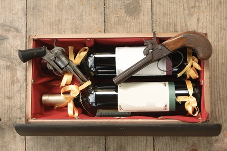 Old gun and wine photo