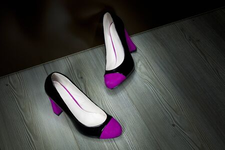 two women shoes pink photo