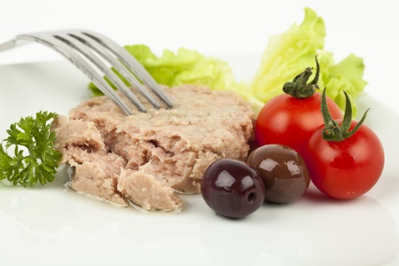 Canned tuna chunks with tomato cherries and olives Stock Photo