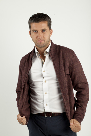 belonging to the caucasoid race: a handsome young man in shirt and vest   Stock Photo