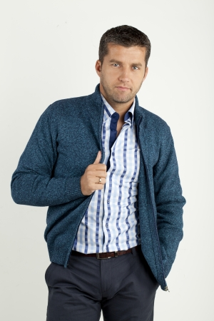 a handsome young man in shirt and vest   photo
