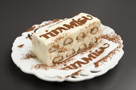 tiramisu cake on the white plate  photo