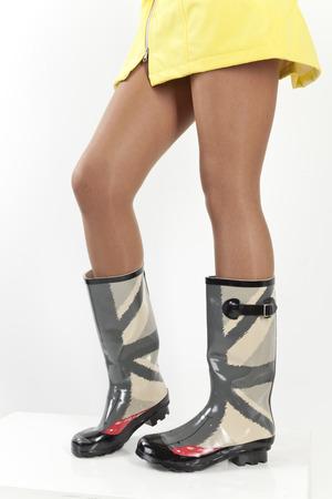 women legs in rubber boots  photo