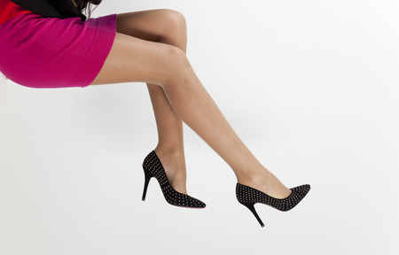 women legs in black shoes  photo