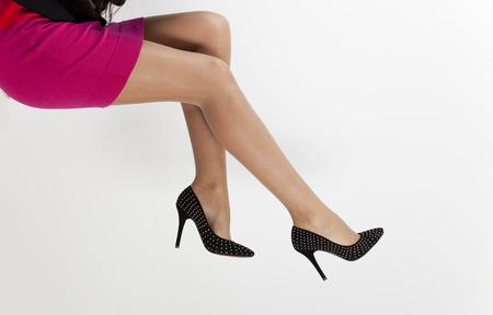 women legs in black shoes  photo