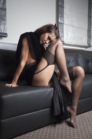 sexy girl in black lingerie posing on black bed