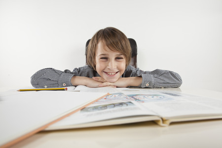 school boy hate learning on white backgroung photo