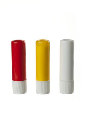 lips red: Peque�o �rbol de b�lsamo labial de pl�stico aisladas en blanco