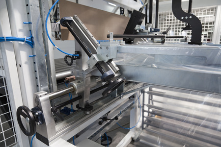 plastic industry: Detail of packaging machine for rolls