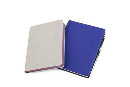 moleskine: blue notebook isolated on white