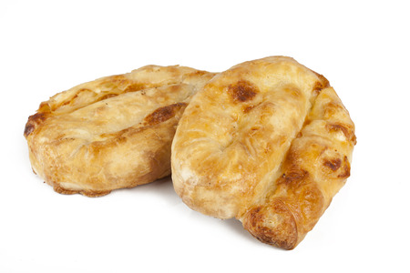 chese: roled pie with chese on white background