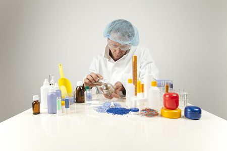 granules: technician working with plastic granules