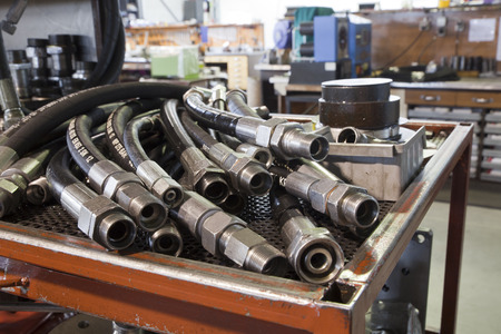 hoses: hydraulic hoses on the table in the workshop