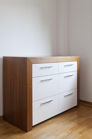 drawers: wooden chest of drawers in the room