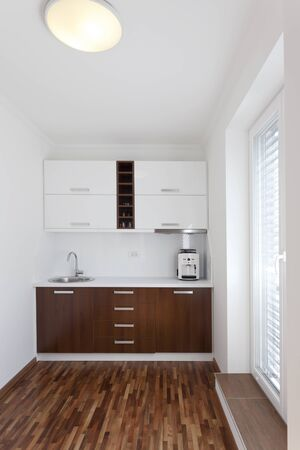 smal: smal white kitchenin apartment