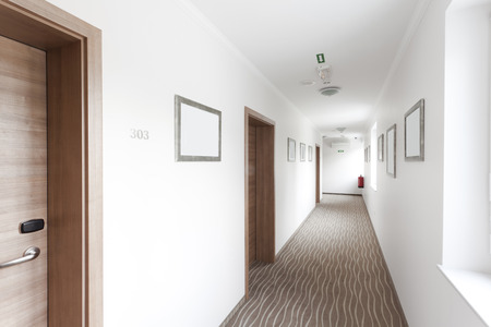 hotel hallway with many doors Stock Photo