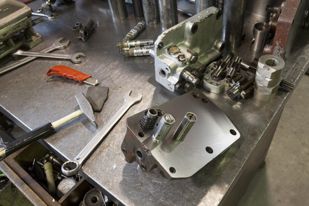 work table: hydraulic engine parts  on the work table