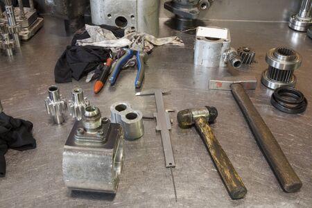hydraulic: hydraulic engine parts  on the work table