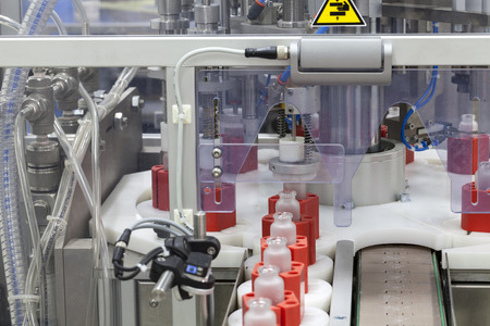 part of the machine for the automatic filling of perfume