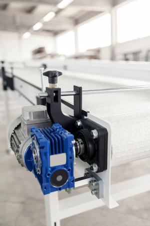 conveyer: conveyer belt close up Stock Photo
