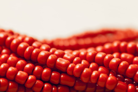 perls: Red pearls background close up