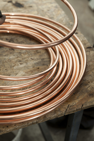 cuprite: bent copper pipes close up Stock Photo
