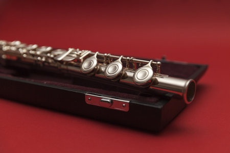 woodwind: flute in a black box on a red background