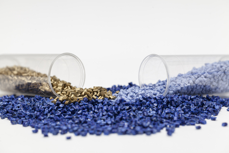 granules: plastic granules, blue and gold close up Stock Photo
