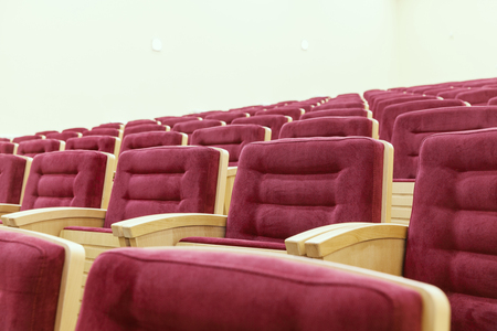 cinema room with red chairs