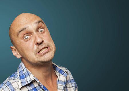 desperate: portrait of desperate man on blue background
