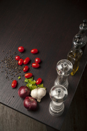 tomatto: food decor on wooden table with vegetables Stock Photo