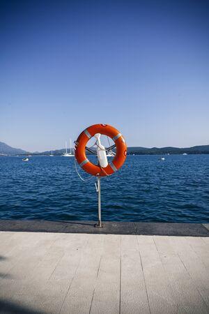 life preserver: life preserver on dock, sea view
