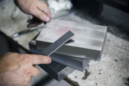 filing: filing metals with hands, close up Stock Photo