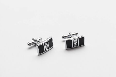 cuff link: silver cufflinks on white background, close up Stock Photo