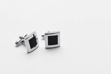 cuff: silver cufflinks on white background, close up Stock Photo