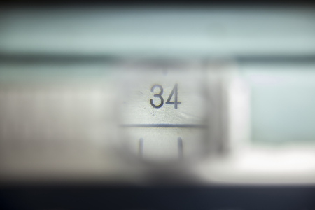 number 36: number 34 on the measuring instrument through a magnifying glass
