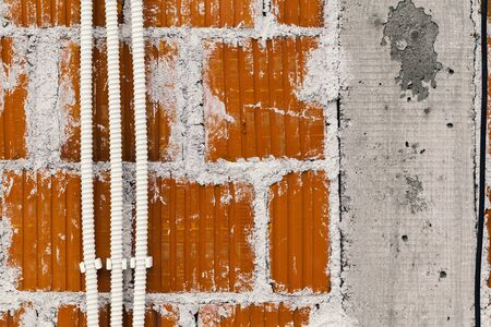 plastered wall: plastered brick wall with plastic corrugated tubes for the electrical installation Stock Photo