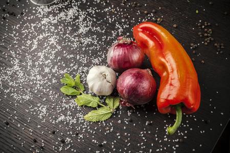 vegetables on a wooden table, paprika, garlic, mushrooms, fresh mint