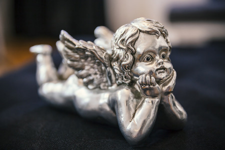 silver baby angel, close up